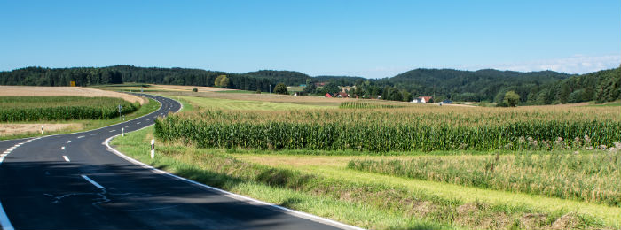 landscape image of a field and road