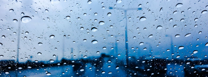 a car window with rain running down the windscreen
