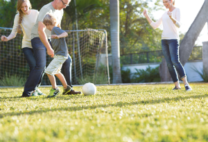 family playing soccer