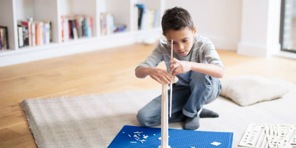 Boy building set